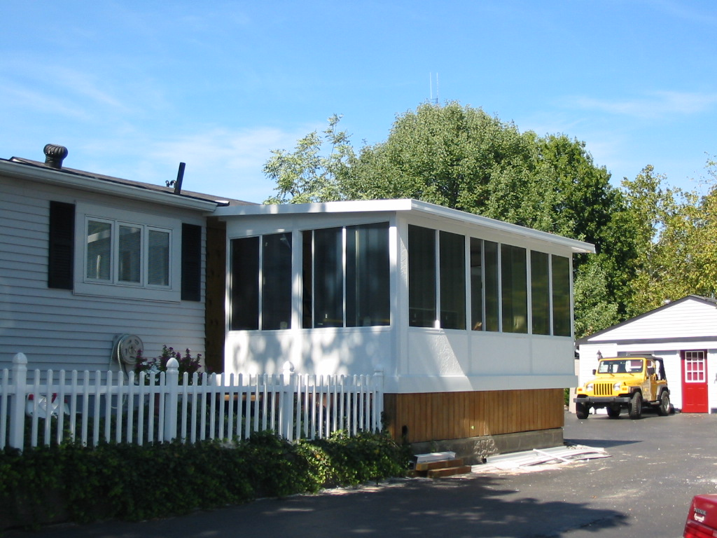 Straight Eave Solid Roof Design White with solid kickpanels on CONSERVADeckTM  Subfloor system