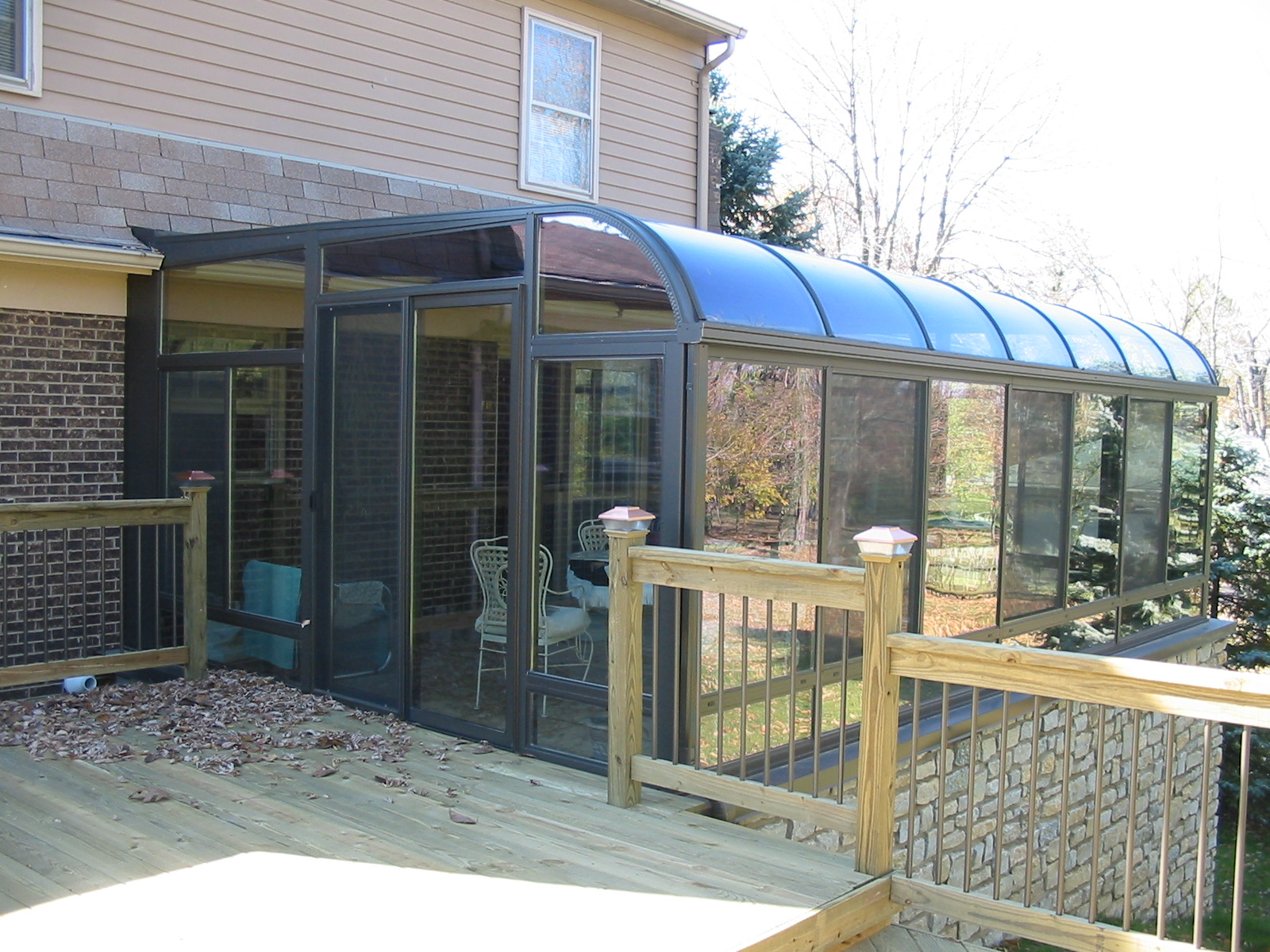 Curved Eave Glass Roof Design Bronze with glass kickpanels and slider door