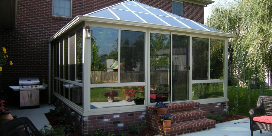 Sandtone interior and exterior with glass kick panels