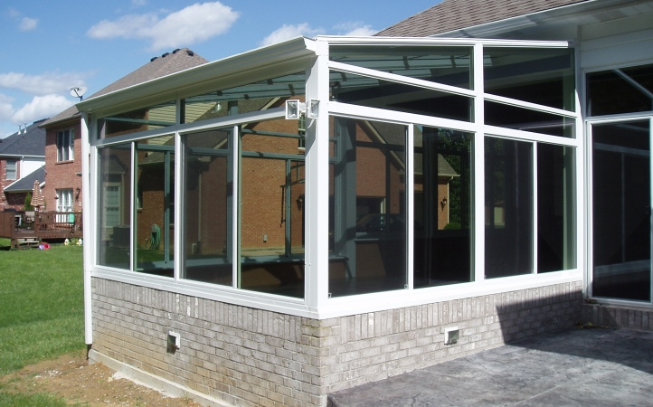 White interior and exterior with glass trapezoids and transoms