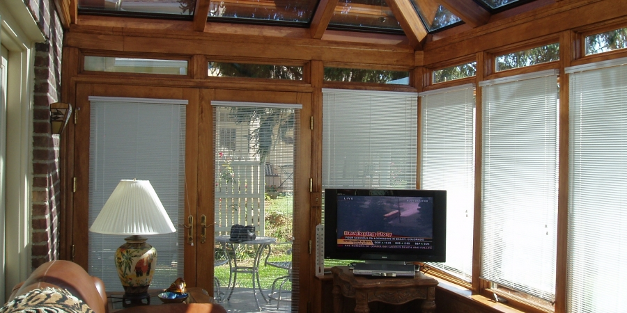 Bronze exterior and Northern White Pine interior with glass transoms