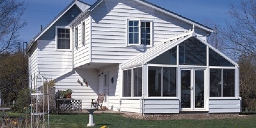 White interior and exterior with glass trapezoids and vinyl siding basewall