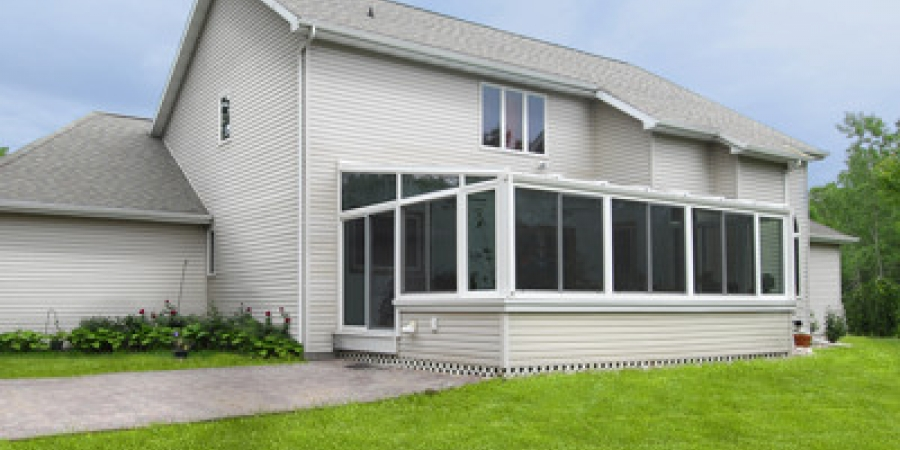 White interior and exterior with casement windows and glass trapezoids