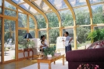 Curved Eave Wood Glass Roof Design Northern white pine interior with sliding doors and awning windows