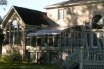 Curved Eave Glass Roof Design Sandtone on upgraded existing deck