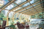 Curved Eave Glass Roof Design Bronze exterior Northern white pine interior with awning windows