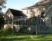 Curved Eave Glass Roof Design Sandtone on upgraded existing deck